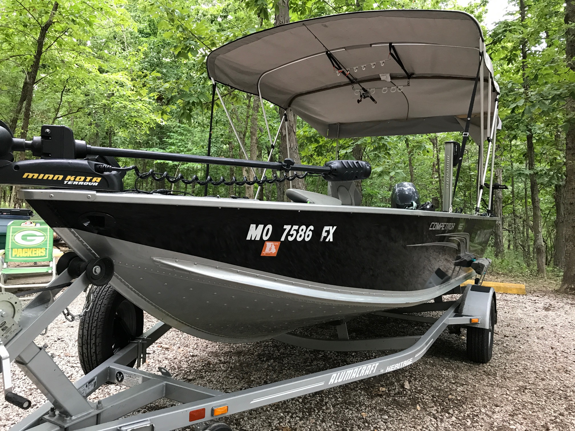 I extended the Bimini top to make a full canopy to the back of the boat. Rain or hot sun are kept where they belong away from me! & Hot Crappie Bite! - Stockton Lake - OzarkAnglers.Com Forum
